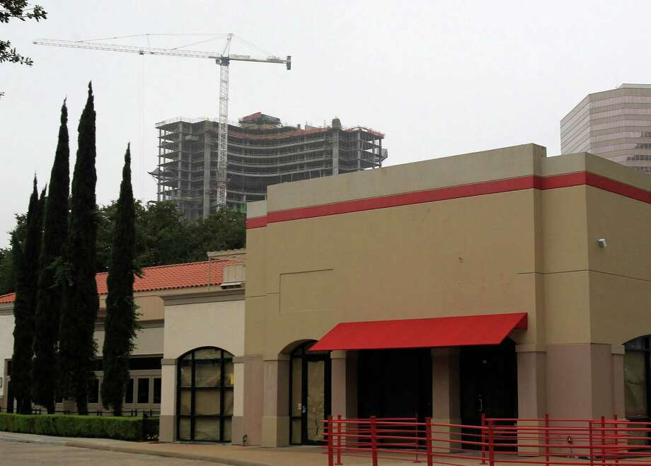 Houston-based AmREIT has owned the Courtyard at Post Oak property, at the corner of Post Oak Boulevard and San Felipe, for almost a decade. Photo: Mayra Beltran, Staff / © 2014 Houston Chronicle