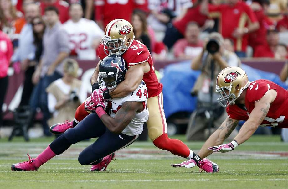 Michael Wilhoite, shown wrapping up Houston's Ben Tate, had 20 tackles over consecutive starts last season. Photo: Beck Diefenbach, Associated Press