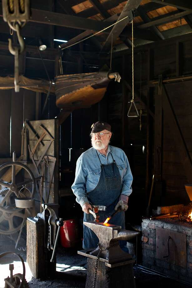 Merv Young's volunteer role as a blacksmith at the Marshall Gold Discovery State Historic Park helps students relive history. Photo: Jason Henry, Special To The Chronicle