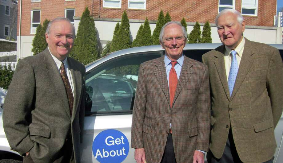 New Canaan residents Mike Glazer, left, and Kevin McMahon, center, recently joined the Getabout Board of Directors. They are shown with Getabout President Bob Witt. Photo: Contributed Photo, Contributed / New Canaan News Contributed