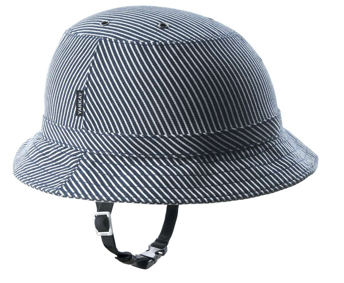 Denmark company Yakkay began selling its vaguely equestrian/safari helmets in the U.S. in 2012 (starting at about around $150), which are a perfect complements to relaxed preppy bike style. Pictured is the Tokoyo Stripe.