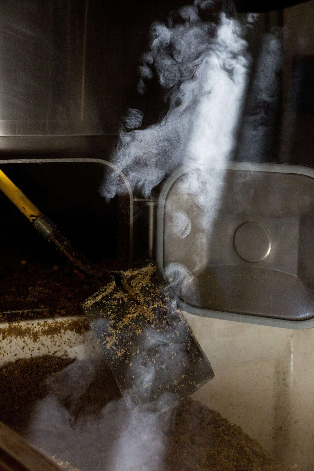 Steam rises as hot mash is moved out of a fermenter at the Jack Russell Brewery in Camino, Calif., Saturday, February 21, 2014.
