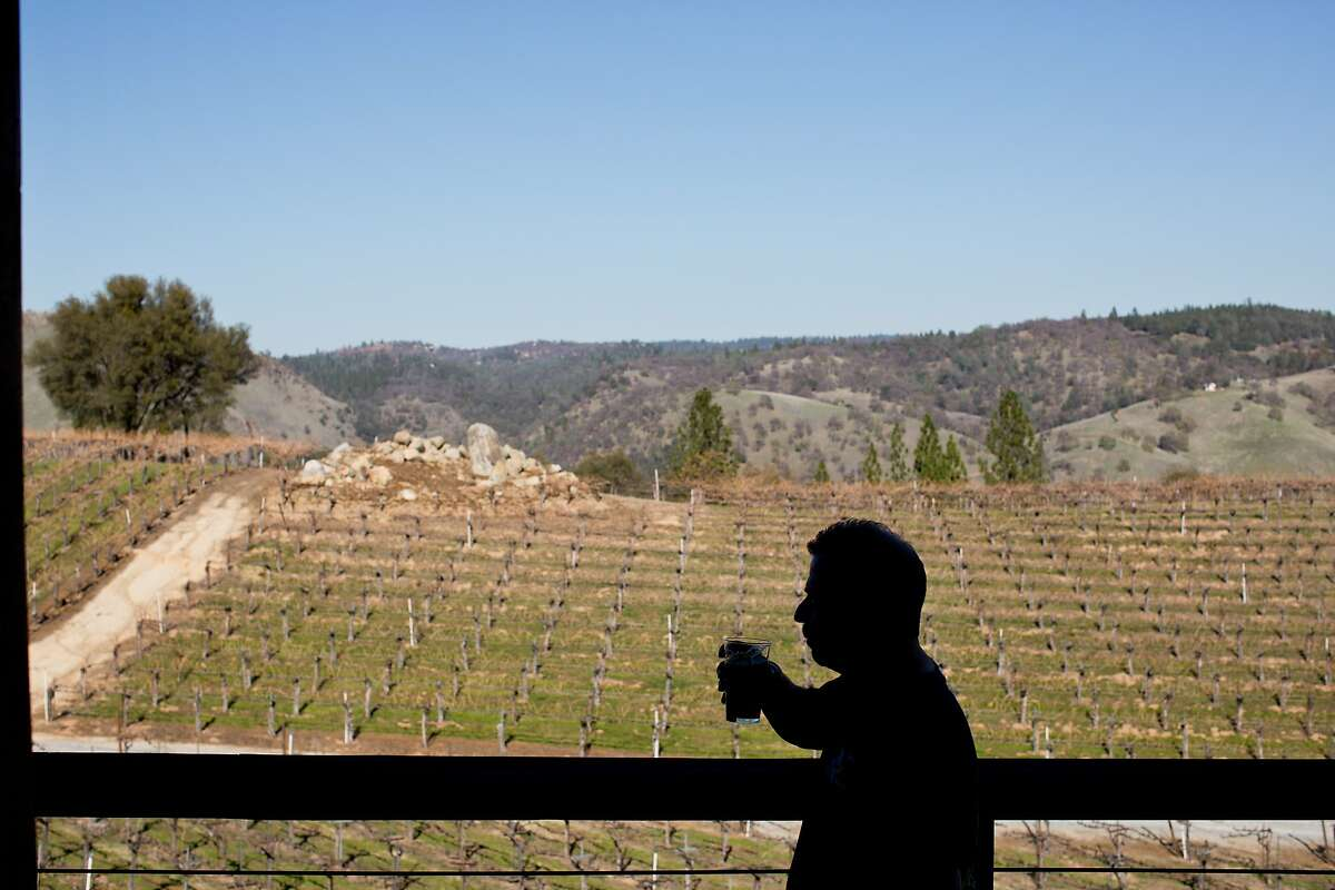 Volunteer Gary Ritz tastes beer on the deck overlooking Gold Hill Vineyard and Brewery which has seven different kinds of beer for guests to try in Placerville, Calif., Saturday, February 21, 2014.