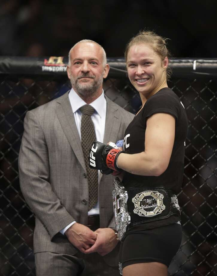 Ronda Rousey, right, smiles with UFC owner Lorenzo Fertitta following her UFC 170 mixed martial arts women's bantamweight title fight against Sara McMann on Saturday, Feb. 22, 2014, in Las Vegas. (AP Photo/Isaac Brekken) Photo: Isaac Brekken, Associated Press