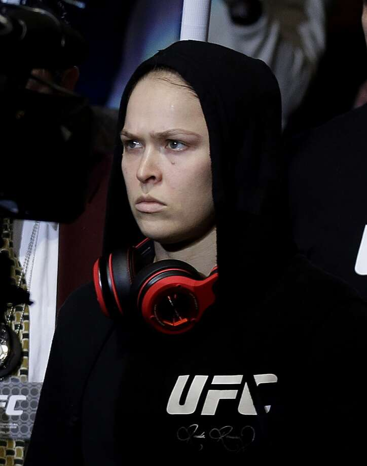 Ronda Rousey  enters the arena for a UFC 170 mixed martial arts women's bantamweight title fight against Sara McMann on Saturday, Feb. 22, 2014, in Las Vegas. (AP Photo/Isaac Brekken) Photo: Isaac Brekken, Associated Press