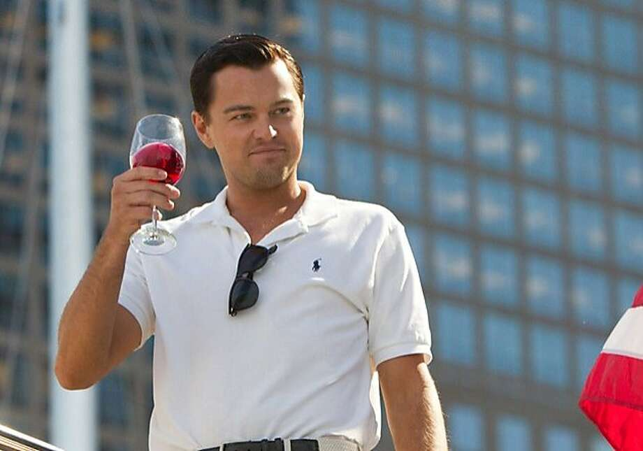 Leonardo DiCaprio plays Jordan Belfort in THE WOLF OF WALL STREET, from Paramount Pictures and Red Granite Pictures. Photo: Mary Cybulski, Paramount Pictures