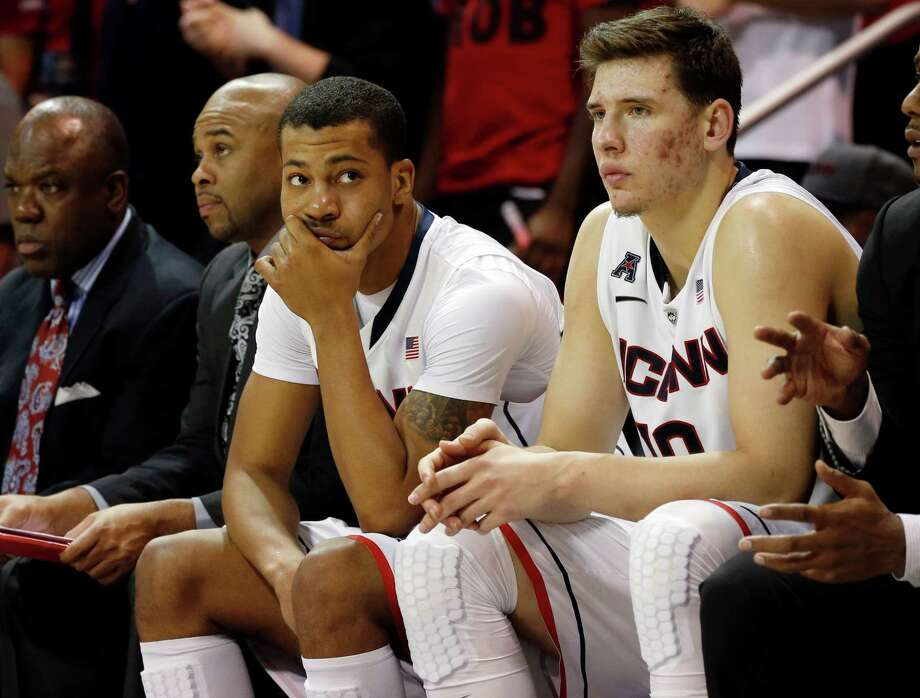 Connecticut guard Omar Calhoun (21) and forward Tyler Olander (10) watch as time runs out in a NCAA college basketball game against SMU on Saturday, Jan. 4, 2014, in Dallas. Connecticut lost 74-65. (AP Photo/John F. Rhodes) Photo: John F. Rhodes, Associated Press / Associated Press