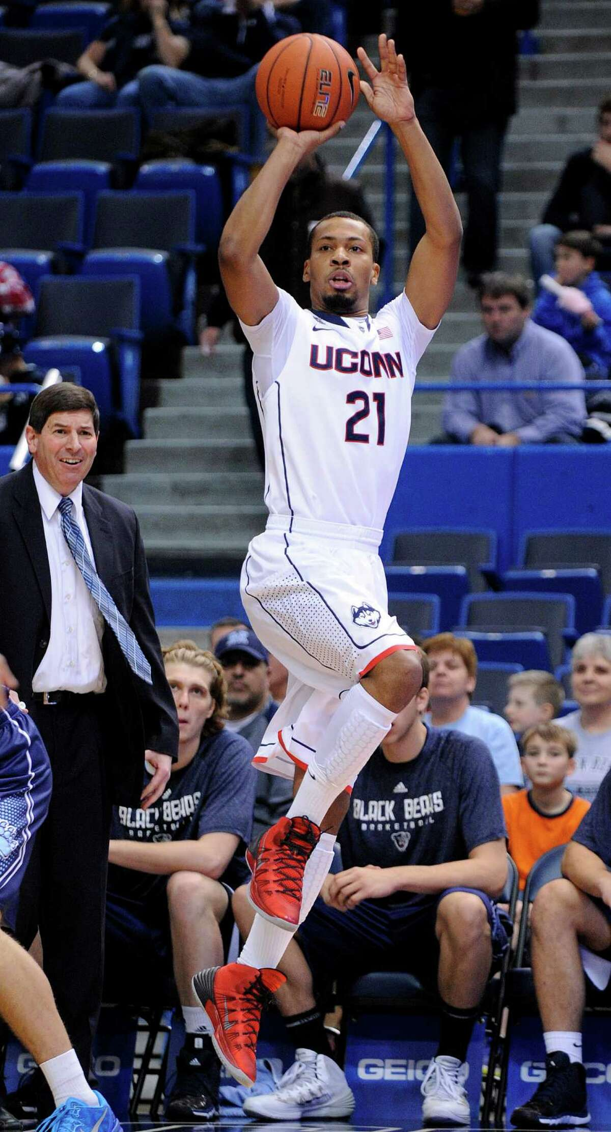 Connecticut's Omar Calhoun (21) shoots during the first half of Connecticut's 95-68 victory over Maine in an NCAA college basketball game, in Hartford, Conn., on Friday, Dec. 6, 2013. (AP Photo/Fred Beckham)