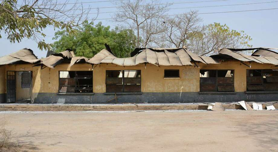 Militants torched a northeast Nigerian school, shooting and slitting the throats of those who escaped through windows. Photo: Associated Press / AP