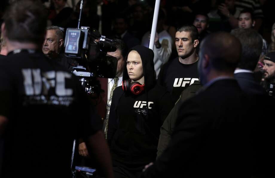 Ronda Rousey enters the arena for her UFC 170 mixed martial arts women's bantamweight title fight against Sara McMann on Saturday, Feb. 22, 2014, in Las Vegas. (AP Photo/Isaac Brekken) Photo: Isaac Brekken, Associated Press