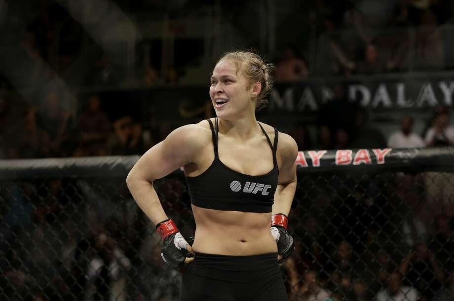 Ronda Rousey reacts after defeating Sara McMann following a UFC 170 mixed martial arts women's bantamweight title bout on Saturday, Feb. 22, 2014, in Las Vegas. (AP Photo/Isaac Brekken) Photo: Isaac Brekken, Associated Press