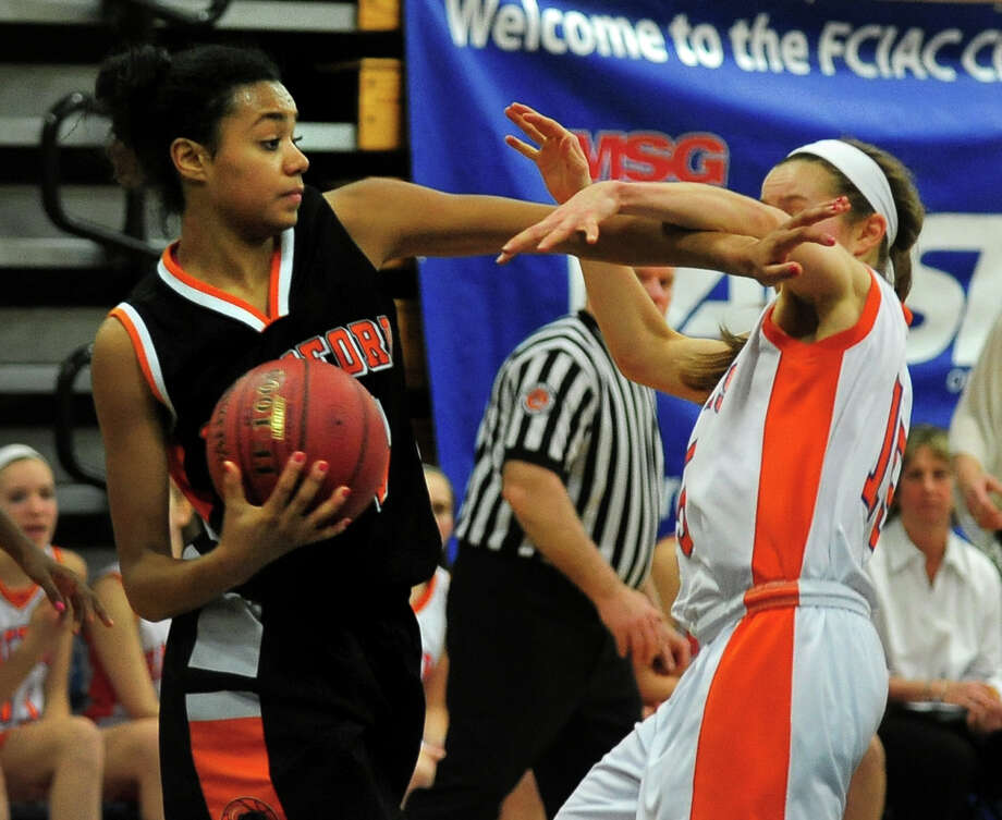 Stamford's Brianna Gordon, left, fends off Danbury's Rebecca Gartner after getting a rebound, during FCIAC Girls' Basketball Semi-final action in Fairfield, Conn. on Tuesday February 25, 2014. Photo: Christian Abraham / Connecticut Post