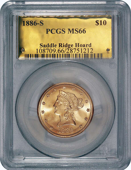 """One of the 1800s-era U.S. gold coins, unearthed in California by two people who want to remain anonymous, is presented here in professional numismatist's trappings, but the coins were originally found buried in rusty cans. The value of the """"Saddle Ridge Hoard"""" treasure trove is estimated at $10 million or more. Photo: Associated Press / Saddle Ridge Hoard discoverers v"""