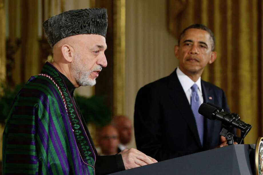 FILE - This Jan. 11, 2013 file photo shows President Barack Obama listening as Afghan President Hamid Karzai speaks during a news conference in the East Room at the White House in Washington. President Barack Obama has ordered the Pentagon to plan for a full American withdrawal from Afghanistan by the end of this year should the Afghan government refuse to sign a security agreement with the US the White House said Tuesday. (AP Photo/Charles Dharapak, File) ORG XMIT: WX108 Photo: Charles Dharapak / AP