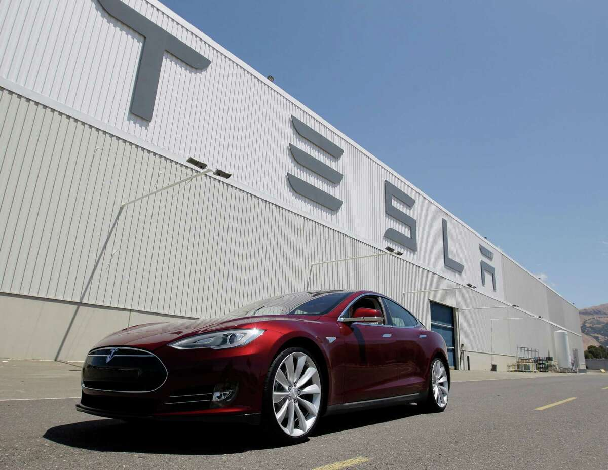 This June 22, 2012 file photo shows a Tesla Model S outside the Tesla factory in Fremont, Calif. The Tesla Model S electric sedan is Consumer Reports' top pick in this year's automotive survey. (AP Photo/Paul Sakuma, File)