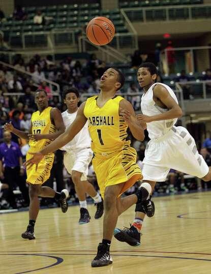 Marshall'sOscar Wilhite loses control of the ball during a high school boys basketball regional quar