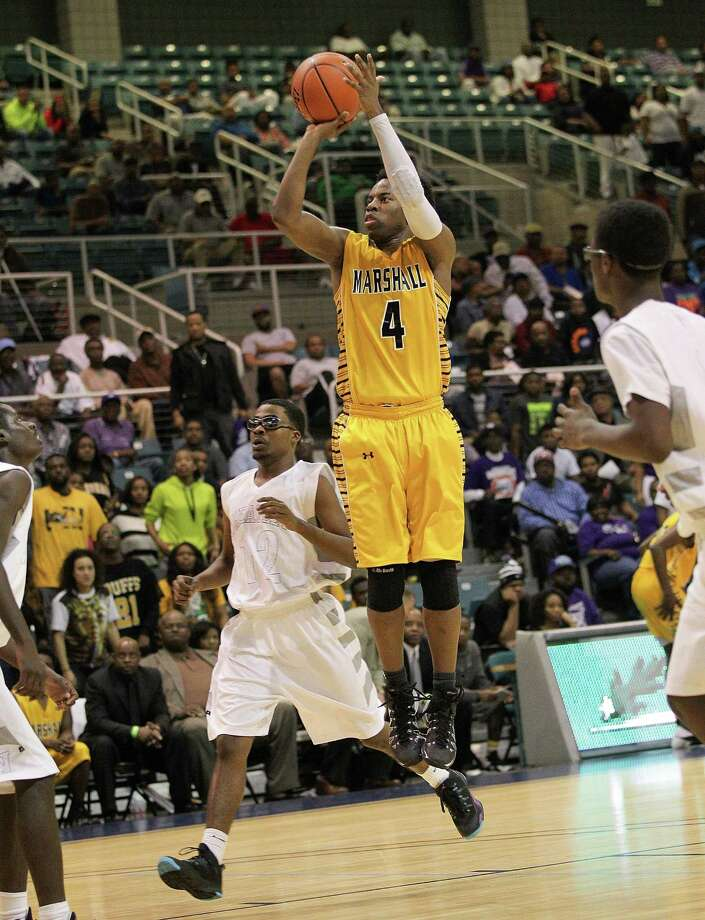 Marshall's D.J. Day shoots a short jumper in the  fourth quarter during a high school boys basketball regional quarterfinal playoff game between Fort Bend Marshall and Wheatley at the Merrill Center in Katy, Texas . Photo: Bob Levey / ©2014 Bob Levey