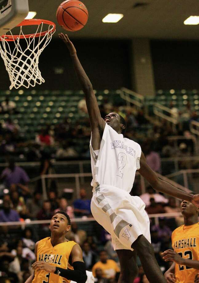 Wheatley's Ronald Johnson drives for a layup against Marshall during a high school boys basketball regional quarterfinal playoff game between Fort Bend Marshall and Wheatley at the Merrill Center in Katy, Texas . Photo: Bob Levey / ©2014 Bob Levey