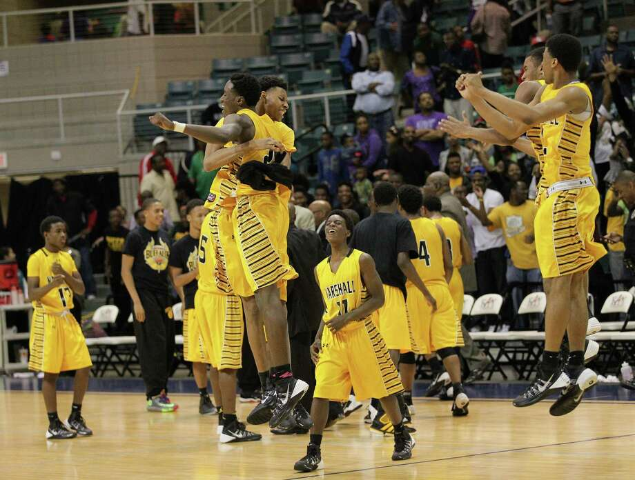 Marshall celebrates their 81-78 win during a high school boys basketball regional quarterfinal playoff game between Fort Bend Marshall and Wheatley at the Merrill Center in Katy, Texas . Photo: Bob Levey / ©2014 Bob Levey
