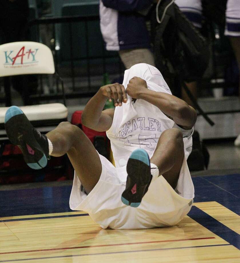 Wheatley's Gerald Thomas reacts after losing to Marshall 81-78 during a high school boys basketball regional quarterfinal playoff game between Fort Bend Marshall and Wheatley at the Merrill Center in Katy, Texas . Photo: Bob Levey / ©2014 Bob Levey