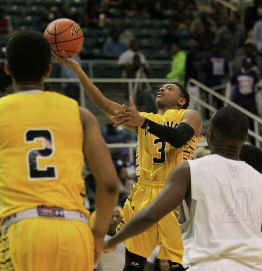 Fort Bend Marshall 81, Wheatley 78Marshall's Jadier  Richardson drives for a layup in