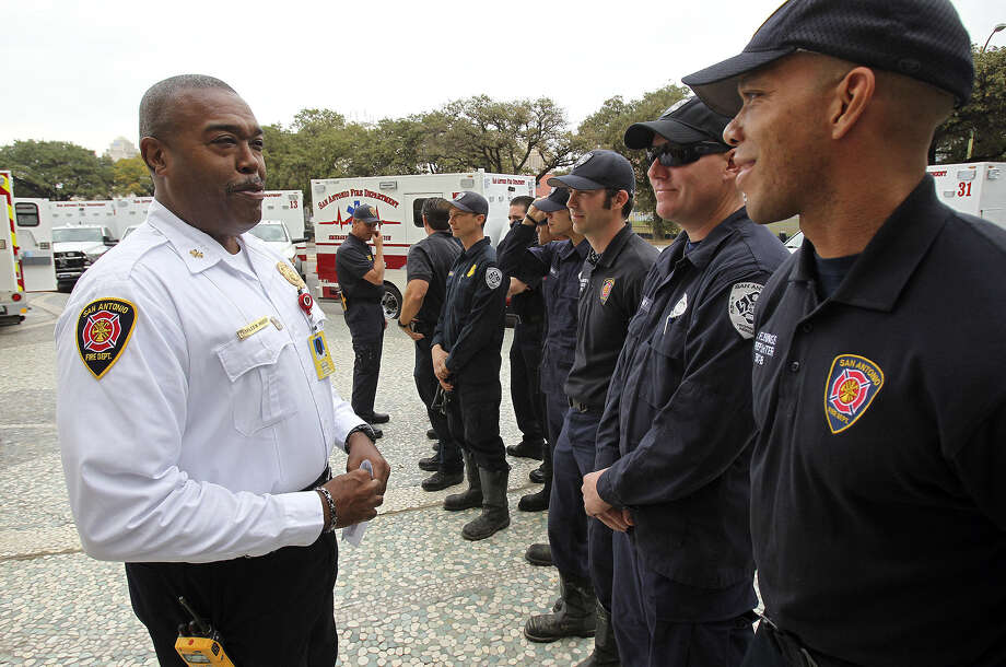 Fire Chief Charles Hood greets EMS technicians as the SAFD unveils its new fleet of ambulances, which are enhanced with new patient and safety features, at SAPD headquarters. Photo: Tom Reel / San Antonio Express-News