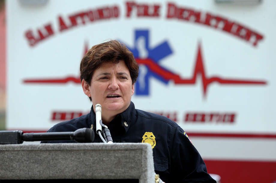 EMS chief Yvette Granato speaks as the SAFD unveils its new fleet of ambulances by rolling out 16 of the units at SAPD headquarters on February 25, 2014. Photo: For The San Antonio Express-News