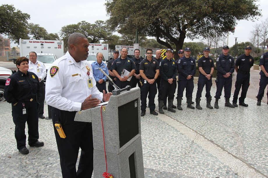 tFire Chief Charles Hood speaks with EMS technicians assembled as the SAFD unveils its new fleet of ambulances by rolling out 16 of the units at SAPD headquarters on February 25, 2014. Photo: For The San Antonio Express-News