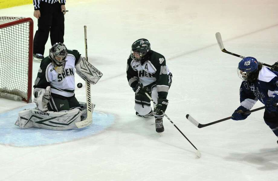 Shenendehowa goalie Ben Farstad stops a shot by Saratoga's J T Rafferty during the section ll hockey final at Union College on Tuesday, Feb. 25, 2014 in Schenectady, N.Y.  (Lori Van Buren / Times Union) Photo: Lori Van Buren / 10025885A