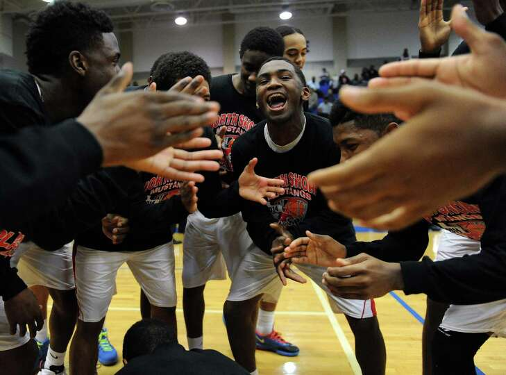 North Shore's Dominique Poledore, center, gets his teammates fired up before the Class 5A Region 3 q