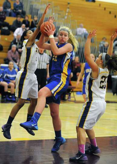 Queensbury's Jill Davis pulls down a defensive rebound during their Class A girls' basketball semifi