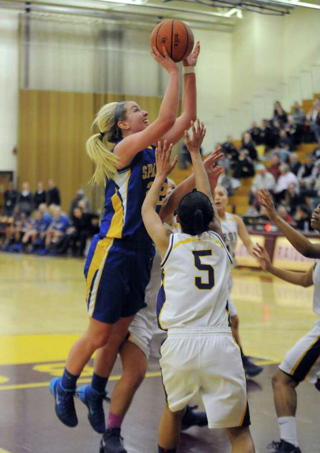 Queensbury's Jill Davis goes in for a basket during their Class A girls' basketball semifinal against Troy on Tuesday Feb. 25, 2014 in Colonie, N.Y. (Michael P. Farrell/Times Union) Photo: Michael P. Farrell / 10025884A