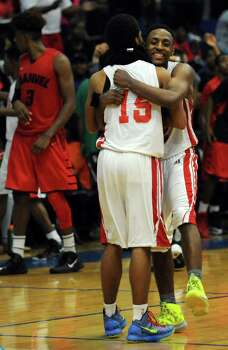 North Shore 71, Manvel 64North Shore's Brandon Etienne, right, and teammate Marion Roy embrace after the Mustangs' victory over Manvel in the Class 5A Region 3 quarterfinal high school basketball playoff game, Tuesday, February 25, 2014, at Clear Springs High School in League City, TX. Photo: Eric Christian Smith, For The Chronicle