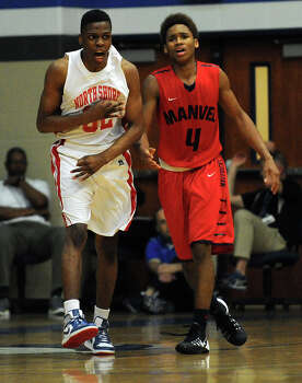 North Shore's Michael Capers, left, cheers his three-pointer as Manvel's Dexter Williams looks on during the second half of the Class 5A Region 3 quarterfinal high school basketball playoff game, Tuesday, February 25, 2014, at Clear Springs High School in League City, TX. Photo: Eric Christian Smith, For The Chronicle