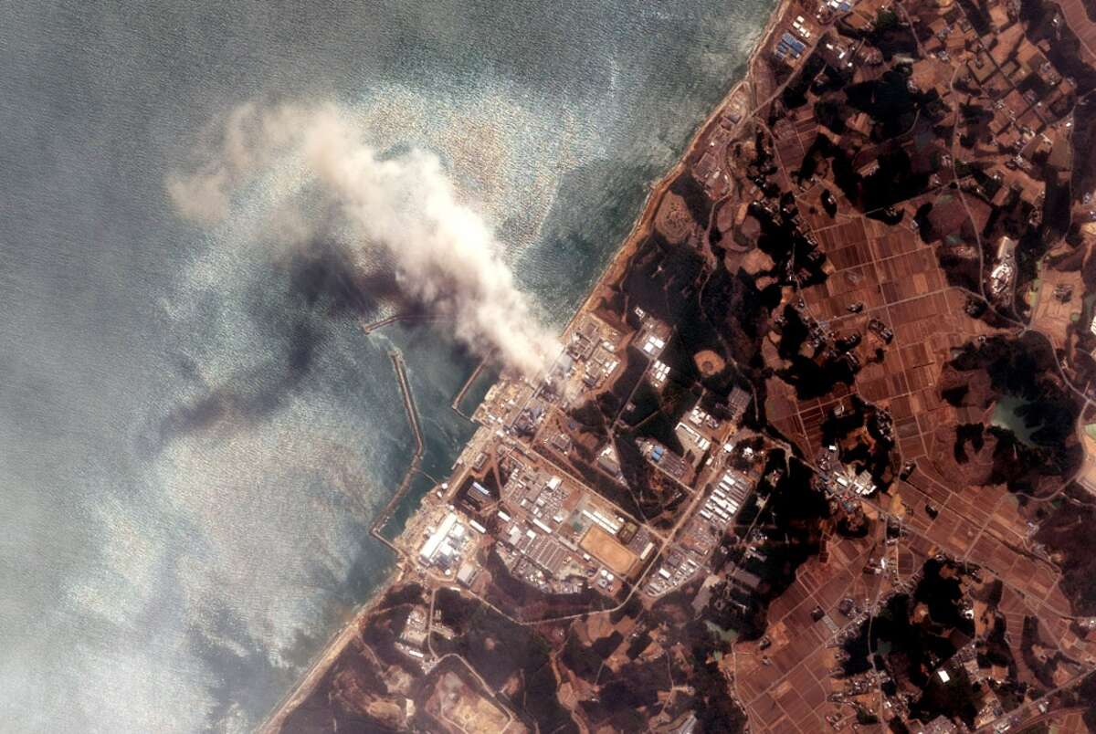 In this satellite view, the Fukushima Dai-ichi Nuclear Power plant after a massive earthquake and subsequent tsunami on March 14, 2011 in Futaba, Japan. Japanese officials reported the fire at the stricken Fukushima nuclear power plant released radioactive material into the air.