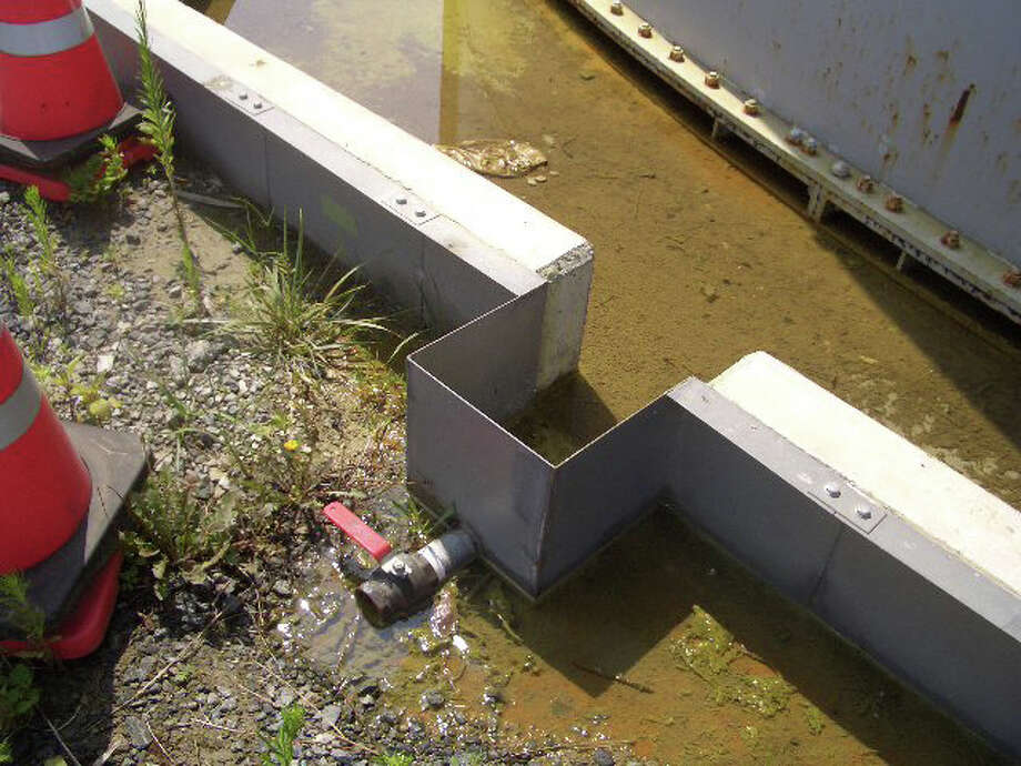In this handout image provided by Tokyo Electric Power Co, leaked radioactive water remains near the tank at the Fukushima Daiichi Nuclear Power Plant on August 19, 2013 in Okuma, Fukushima, Japan. An estimated 300 tons of highly radioactive water has leaked from a tank at the Fukushima nuclear plant, with much of the polluted water apparently seeping into the ground.  (Photo by Tokyo Electric Power Co via Getty Images) Photo: Handout, Getty Images / 2013 Tokyo Electric Power Co