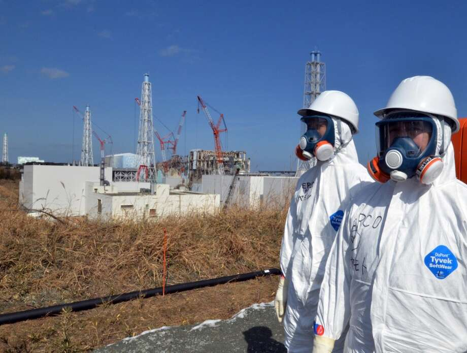 This file picture taken on February 28, 2012 shows workers standing near the stricken Tokyo Electric Power Co (TEPCO) Fukushima Daiichi nuclear power plant in Okuma, Fukushima prefecture.   (YOSHIKAZU TSUNO/AFP/Getty Images) Photo: YOSHIKAZU TSUNO, AFP/Getty Images