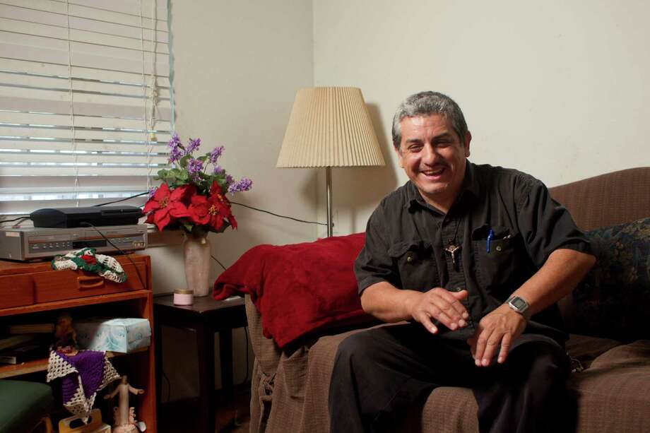 Naturalized U.S. citizen Miguel Andrade says he's been  saddened by the anti-immigrant speech he hears from a man he once saw as a kind and compassionate father figure. Photo: Johnny Hanson, Staff / © 2014  Houston Chronicle