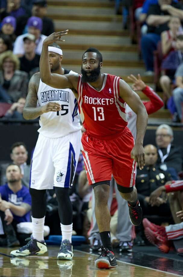 James Harden signals the three-pointer that gave him 30 points in the first half of Houston's victory. Photo: Jose Luis Villegas, McClatchy-Tribune News Service