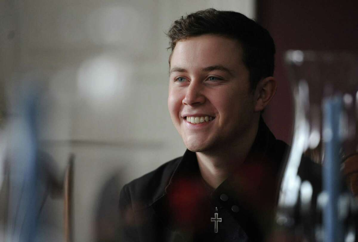 2011 American Idol winner and country music star Scotty McCreery speaks at the Dana Holcombe House in Newtown, Conn. Tuesday, Feb. 25, 2014. McCreery, 20, has been selected to be the goodwill ambassador for the 12.14 Foundation in Newtown.