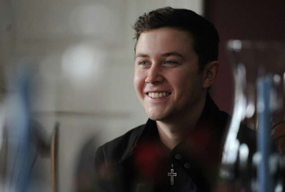 2011 American Idol winner and country music star Scotty McCreery speaks at the Dana Holcombe House in Newtown, Conn. Tuesday, Feb. 25, 2014. McCreery, 20, has been selected to be the goodwill ambassador for the 12.14 Foundation in Newtown. Photo: Tyler Sizemore / The News-Times
