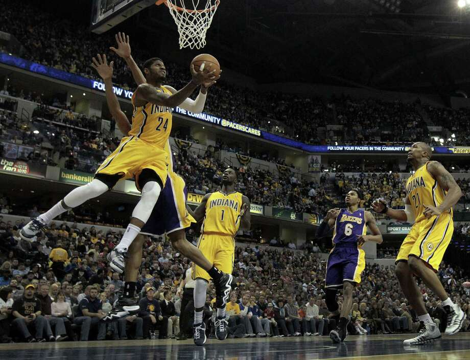 Pacers forward Paul George goes toward the basket around the Lakers' Wesley Johnson during the third quarter of Indiana's victory. George scored 20 points. Photo: AJ Mast / Associated Press / FR123854 AP