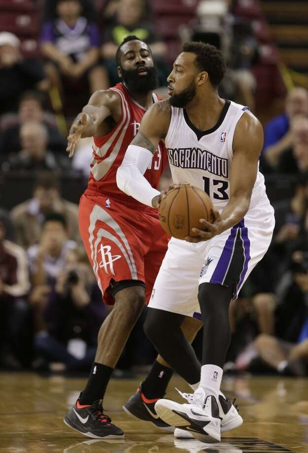 Rockets shooting guard James Harden defends Derrick Williams of the Kings. Photo: Rich Pedroncelli, Associated Press