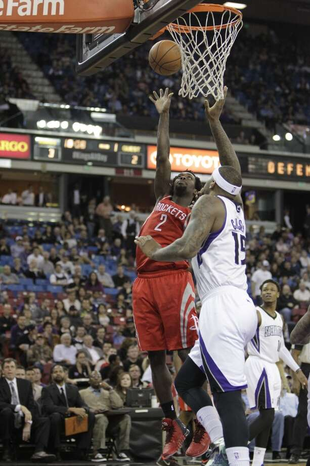 Rockets point guard Pat Beverley shoots over DeMarcus Cousins of the Kings. Photo: Rich Pedroncelli, Associated Press