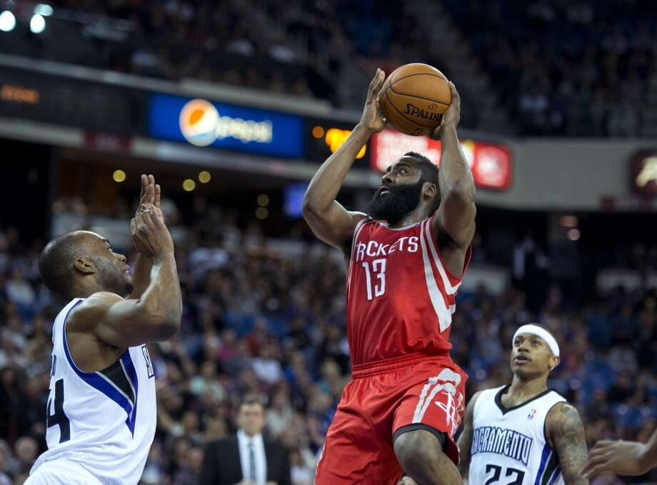 Rockets shooting guard James Harden attempts a shot as Carl Landry of the Kings defends. Photo: Jose Luis Villegas, MCT/Sacramento Bee