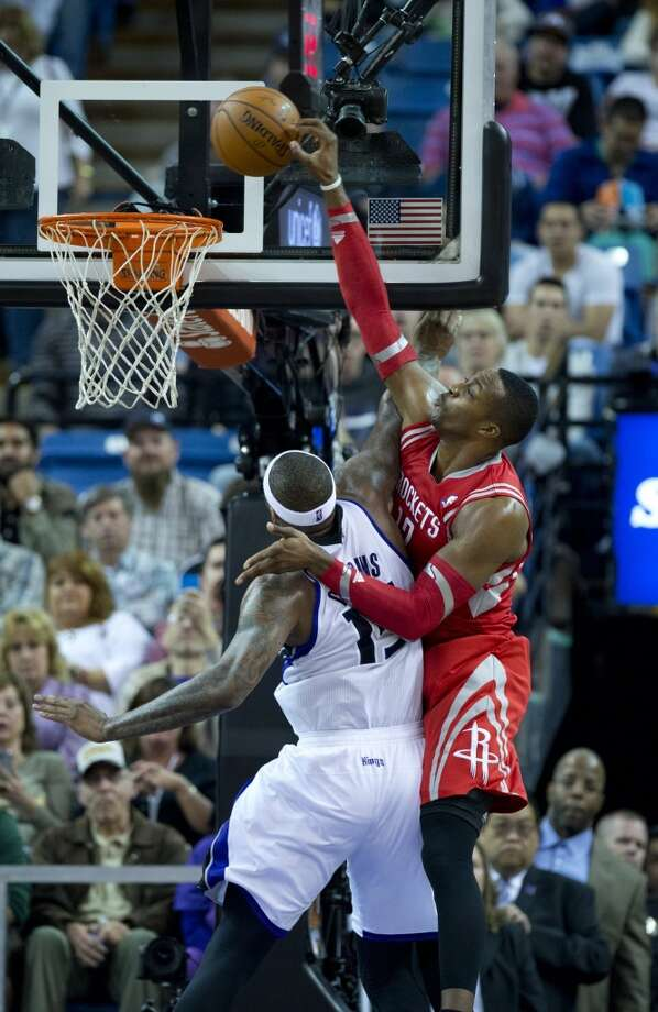 Rockets center Dwight Howard gets fouled by DeMarcus Cousins of the Kings. Photo: Jose Luis Villegas, MCT/Sacramento Bee