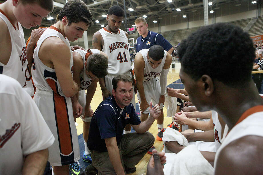 Madison coach Chris Romine talks to his team during a fourth quater time out in their third-round playoff game with East Central at the Alamo Convocation Center on Tuesday, Feb. 25, 2014.  Madison beat the Hornets 64-58.  MARVIN PFEIFFER/ mpfeiffer@express-news.net Photo: MARVIN PFEIFFER, Marvin Pfeiffer/ Express-News / Express-News 2014