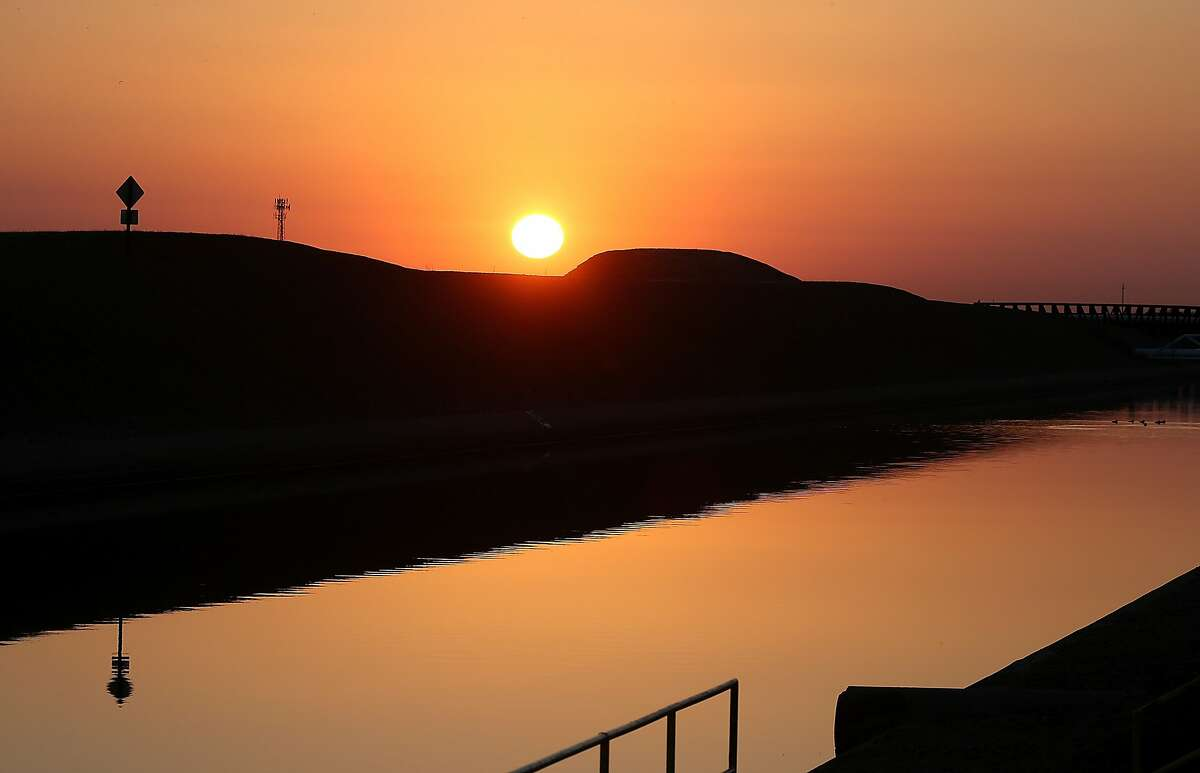 The sun rises over the Delta-Mendota Canal in Los Banos, California. California voters will have their say on a $7 billion water bond measure this November.