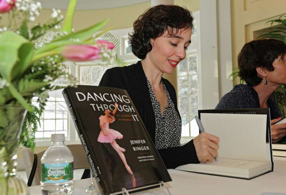 Jenifer Ringer, recently retired principal dancer for the NYC Ballet, signs copies of her book ODancing Through ItO for her fans at the National Museum of Dance on Tuesday, Feb. 25, 2014 in Saratoga Springs, N.Y.  (Lori Van Buren / Times Union) Photo: Lori Van Buren / 00025867A