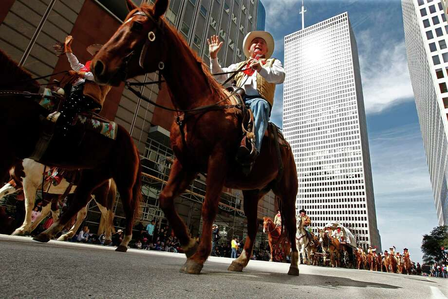 Houston Livestock Show and Rodeo Downtown Rodeo Parade: Saturday, March 1; races from 9:10-9:45 a.m., parade begins at 10 a.m. The parade will start at Walker and Bagby near City Hall, then it will travel up Walker, then right on Travis, another right on Bell and Louisiana, then left on Lamar before ending at Bagby. rodeohouston.com/Events  Photo: Johnny Hanson, Staff / © 2013  Houston Chronicle